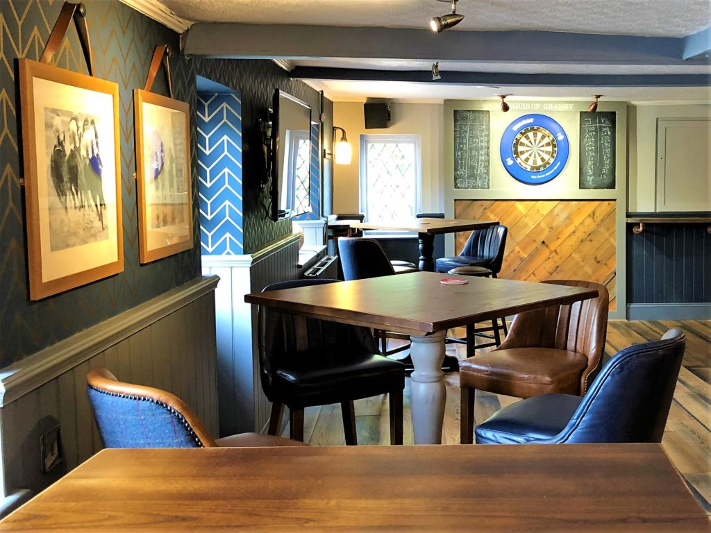 seating in the bar and dartboard at the marquis of granby pub stevenage