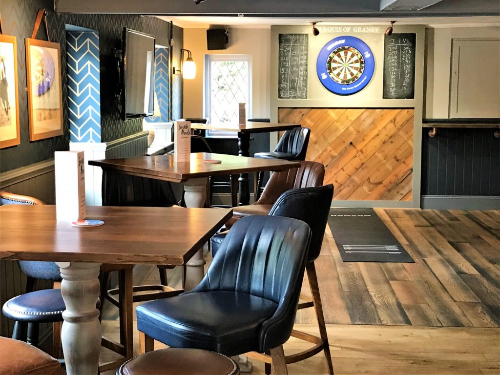 seating and dartboard at the marquis of granby pub stevenage